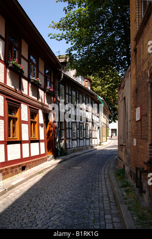 Historic houses along an alley in Wernigerode, Saxony-Anhalt, Germany, Europe - Stock Photo
