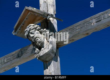 Summit cross, Sexten, Dolomites, Italy - Stock Photo