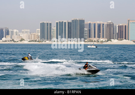 Jetboat Rider in front of the skyline of the Abu Dhabi City, Emirat Abu Dhabi, United Arab Emirates, Asia - Stock Photo