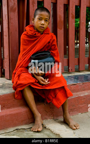 Young monk with rice bowl, Bagan, Burma, Myanmar, Southeast Asia - Stock Photo