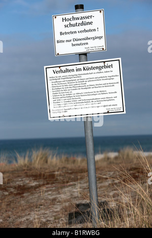 Sign, flood protection dune in Prerow on Darss along the Baltic Sea coast, Nationalpark Vorpommersche Boddenlandschaft, - Stock Photo