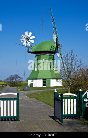 The Erdhollaender, an historic Dutch windmill with wind rose, near Wittmund, East Friesland, Lower Saxony, Germany, - Stock Photo