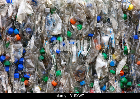Colourful crushed, compacted plastic bottles for recycling - Stock Photo
