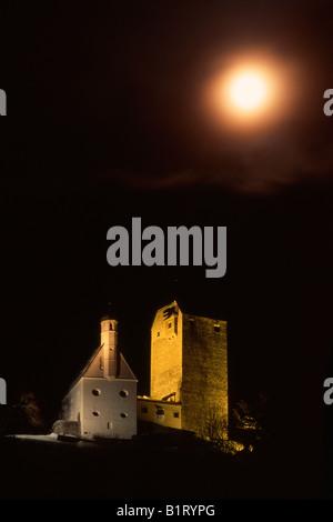 Freundsberg Castle under a full moon, Schwaz, Tyrol, Austria, Europe - Stock Photo