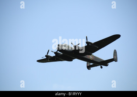 Avro Lancaster from the Battle of Britain Flight over Lincolnshire - Stock Photo