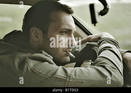 31-year-old man dressed up as James Dean, in a car - Stock Photo