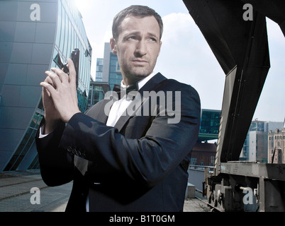 31-year-old man dressed up as James Bond in Duesseldorf Harbour, North Rhine-Westphalia, Germany, Europe - Stock Photo