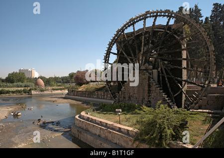 Hama Syria Noria wooden waterwheel on Orontes river - Stock Photo