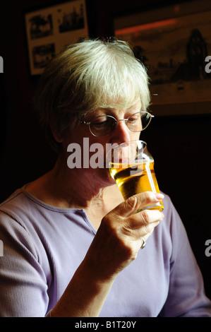 Woman Enjoying a Glass of Cider - Stock Photo