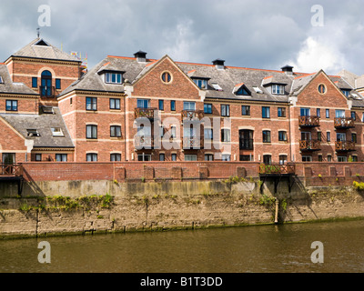 Redeveloped warehouses made into riverside flats apartments on the River Ouse in the centre of York, England, UK - Stock Photo