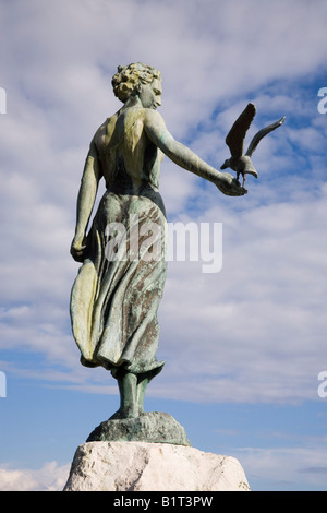 Opatija Istria Croatia Europe May Maiden with the seagull statue on rock by 'Zvonko Car' 1956 close up of back against - Stock Photo