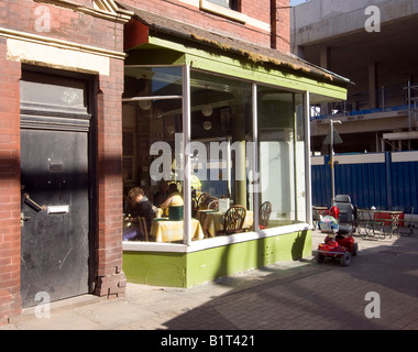 A cafe with a mobility scooter parked outside in the seaside town of Blackpool, Lancashire, UK - Stock Photo