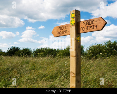 Wooden footpath sign post indicating public footpaths in England, UK - Stock Photo