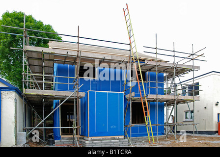 a new timber framed house under construction in england,uk - Stock Photo