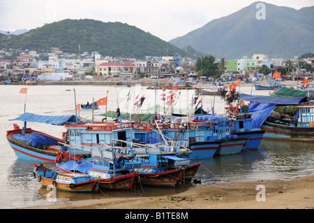 Traditional colourful fishing fleet Nha Trang Vietnam - Stock Photo