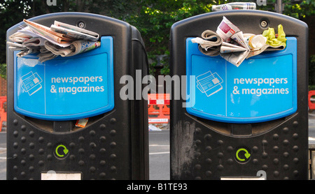 Overflowing recycling bins outside White City tube west London UK - Stock Photo