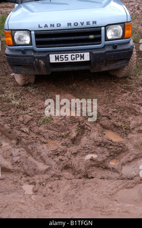 Land Rover Discovery in muddy car park at The Guardian Hay Festival 2008 Hay on Wye Powys Wales UK EU - Stock Photo