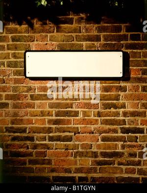 BLANK STREET SIGN ON OLD BRICK WALL - Stock Photo