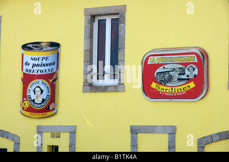 Giant Sardine and Fish Soup cans advertising the Canning Factory in Quiberon, France. - Stock Photo