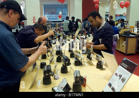 Customers in a new Circuit City electronics store in New York browse the digital cameras and camcorders - Stock Photo