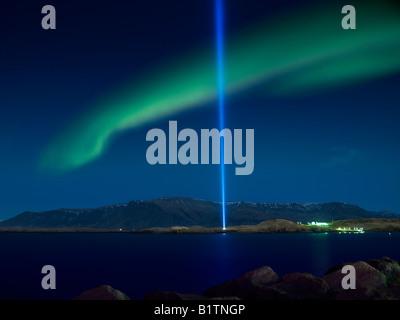 Aurora Borealis with  the Imagine Peace Tower, Videy Island Reykjavik Iceland - Stock Photo