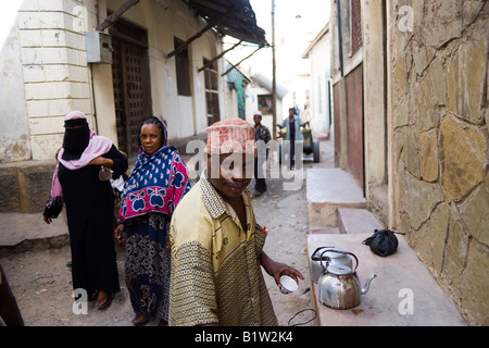 Man selling tea Old Town Mombasa Kenya - Stock Photo