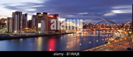 UK North Tyneside Newcastle upon Tyne the Gateshead Millennium Bridge and the sage Building viewed from the Quayside - Stock Photo