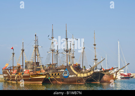 Mock galleon style wooden sailing ships that carry tourists for day cruises along the coast moored in the Hammamet - Stock Photo