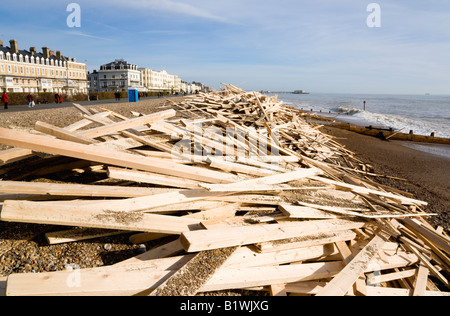 ENGLAND West Sussex Worthing People on promenade walk past timber debris on beach from shipwrecked Ice Princess - Stock Photo