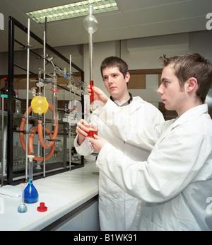 pharmacy students in laboratory experiment - Stock Photo