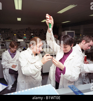 students in laboratory experiment - Stock Photo
