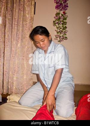 masseuse giving foot massage, massage parlor, Siam Reap, Cambodia - Stock Photo