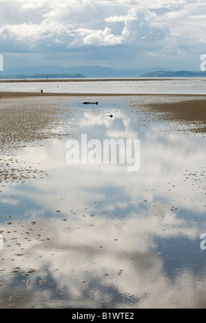 Storm clouds reflected in seawater over Findhorn beach, Moray, Scotland - Stock Photo