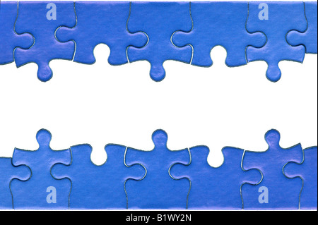 Pieces from a genuine blue jigsaw puzzle arranged to form a page header and footer isolated on a white background - Stock Photo