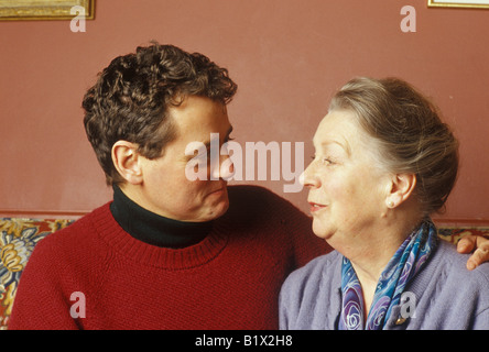 younger man looking at an older woman - Stock Photo