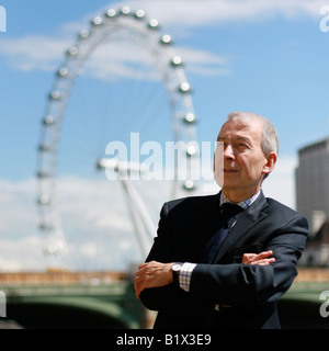 MP Frank Field standing outside the Houses of Parliament with the London Eye in the background, England. - Stock Photo