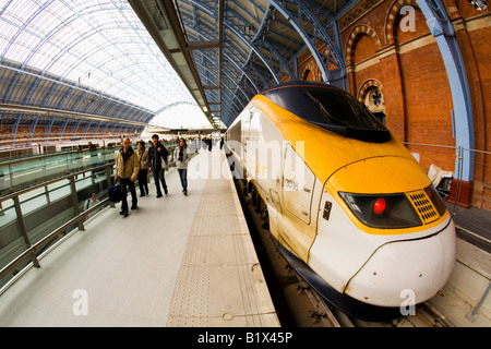 Passengers disembark from Eurostar train on platform at St Pancras Station London England UK United Kingdom GB - Stock Photo