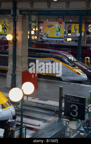 Eurostar trains arrive at platform in Gare du Nord Paris France EU - Stock Photo