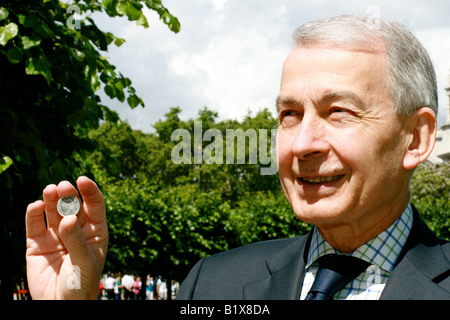 Frank Field holds up a ten pence coin after leading the fight against the government proposed 10p Tax. - Stock Photo