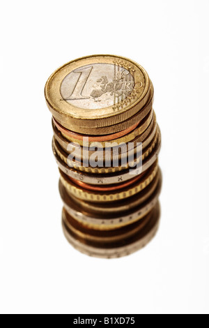 Stack of Euro coins on white background - Stock Photo