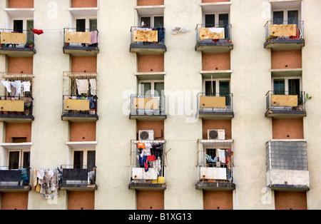 Rows and lines of modified balconies on decayed high rise building. Maputo, Mozambique. - Stock Photo