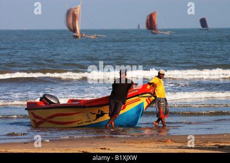 a boat on the beach in negombo, sri lanka - Stock Photo