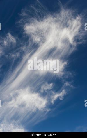 Cirrus Clouds in a bright blue sky in Scotland - Stock Photo