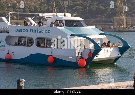 Tourist Boat (Barco Turistico) at Roman City of Cartagena, Murcia, Spain - Stock Photo
