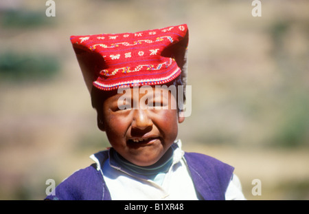 portrait of a little boy on Isla Taquile in Lake Titicaca in Peru - Stock Photo
