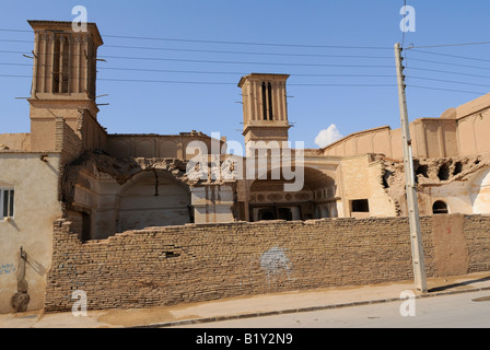 A view of two ancient wind catchers, to be found in the old sector of Yazd - Stock Photo