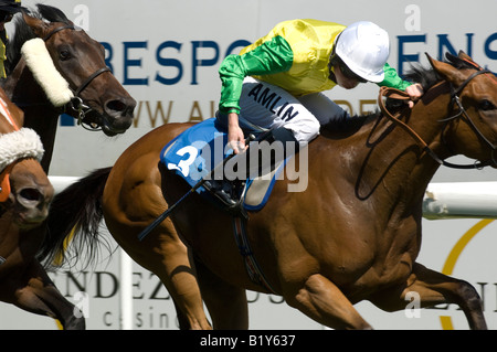 Champion jockey Ryan Moore riding Vigano wins from Benedetto in the second race at Brighton Races - Stock Photo