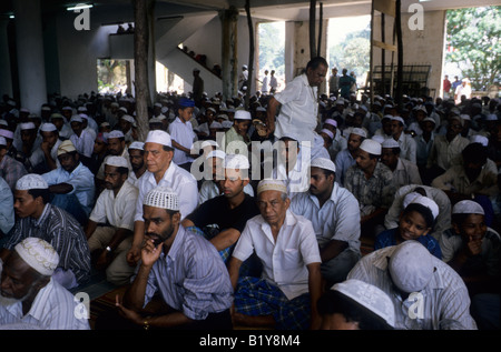 Sunni Muslims attend mid day prayers at a mosque in Colombo Sri Lanka - Stock Photo