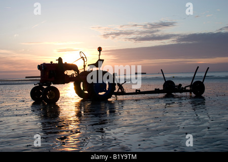 Beach Tractor at lowtide on Arromanches beach, France, Gold Beach, Normandy, the remains of the WW2 Mulberry Harbour - Stock Photo