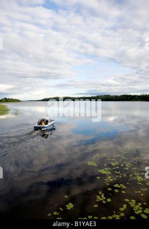 Boat entering Lake Suontee Finland - Stock Photo